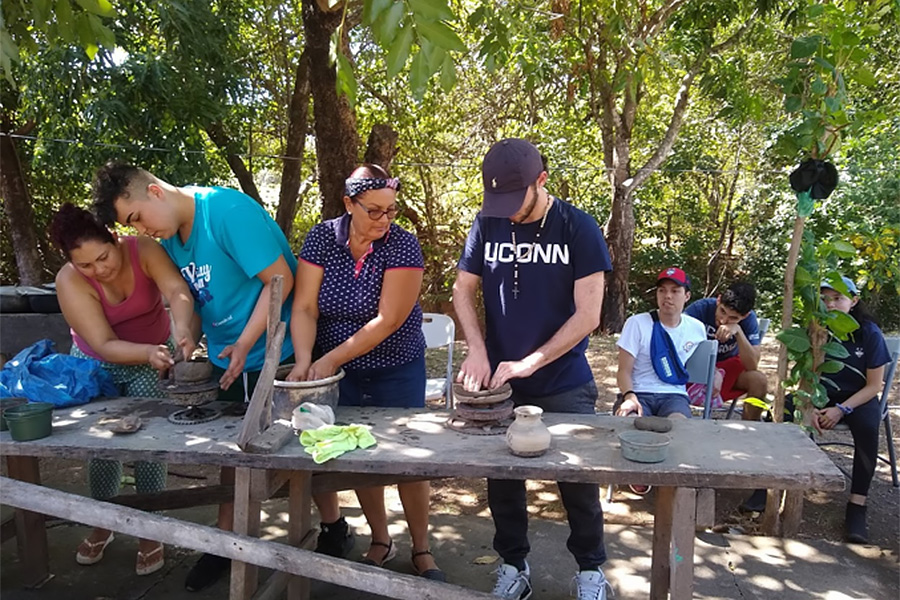 A group of students participate in an outdoor community engagement activity.